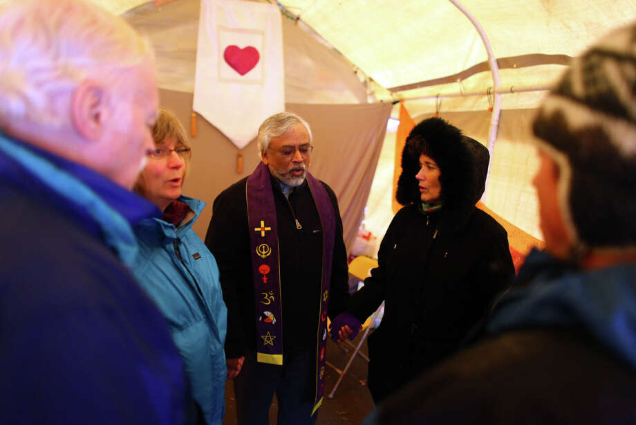 Muslim imam Jamal Rahman, center, leads a chant in the meditation tent on Wednesday, November 23, 2010 at the Occupy Seattle encampment at Seattle Central Community College. Members of the camp were working to clean trash from the camp as a board of community college trustees were voting to evict Occupy Seattle from Seattle Central Community College campus. Photo: JOSHUA TRUJILLO / SEATTLEPI.COM