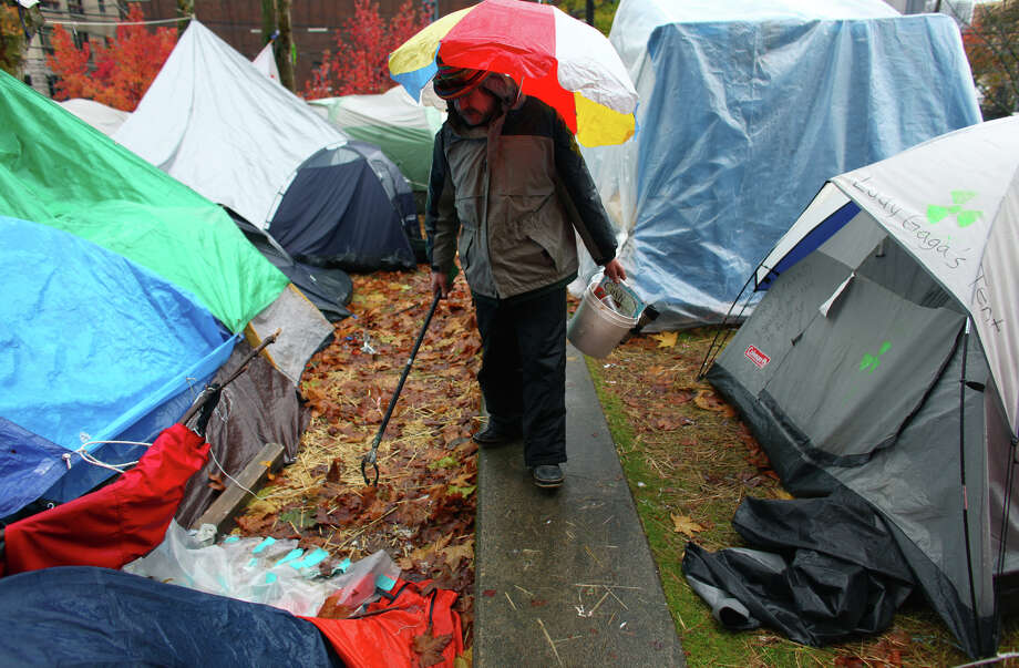 Garth Carroll picks up trash on Wednesday, November 23, 2010 at the Occupy Seattle encampment at Seattle Central Community College. Members of the camp were working to clean trash from the camp as a board of community college trustees were voting to evict Occupy Seattle from Seattle Central Community College campus. Photo: JOSHUA TRUJILLO / SEATTLEPI.COM