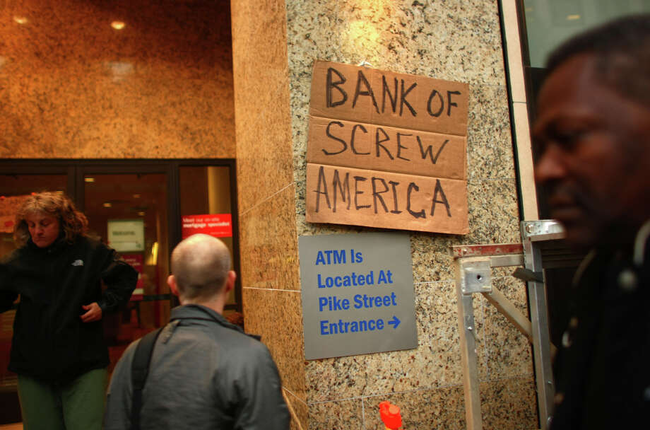A sign is affixed to the Bank of America in Westlake Park during the Occupy Seattle protest on Saturday, October 15, 2011. Photo: JOSHUA TRUJILLO / SEATTLEPI.COM
