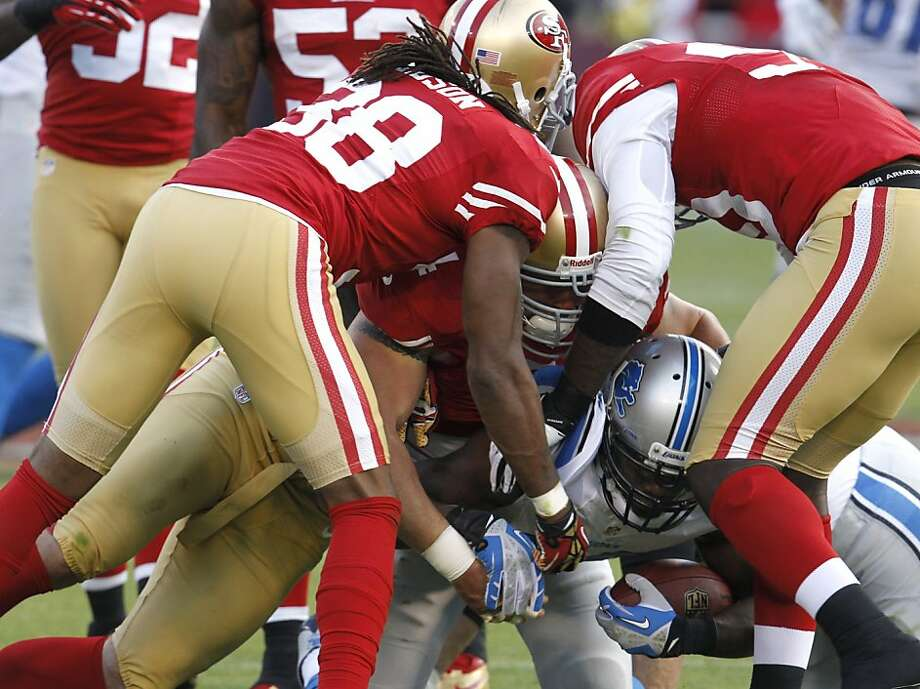 San Francisco 49ers defense takes down Detroit Lions Kevin Smith in the first half of Sunday's game at Candlestick Park in San Francisco, Calif., on Sunday September 16, 2012. Photo: Brant Ward, The Chronicle