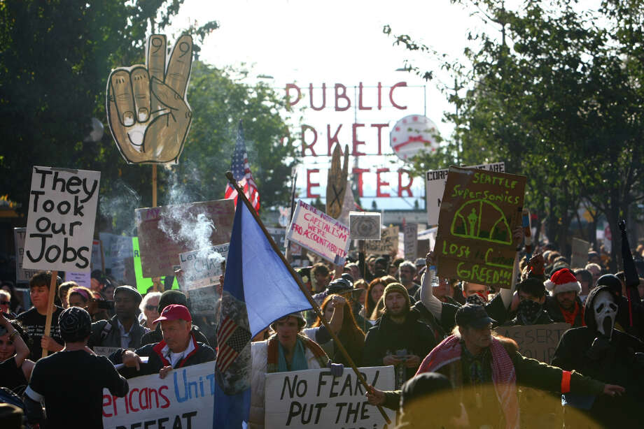 Occupy Seattle protesters march on Saturday, October 15, 2011 in Seattle. About 5,000 people joined the protesters at Westlake Park. Photo: JOSHUA TRUJILLO / SEATTLEPI.COM