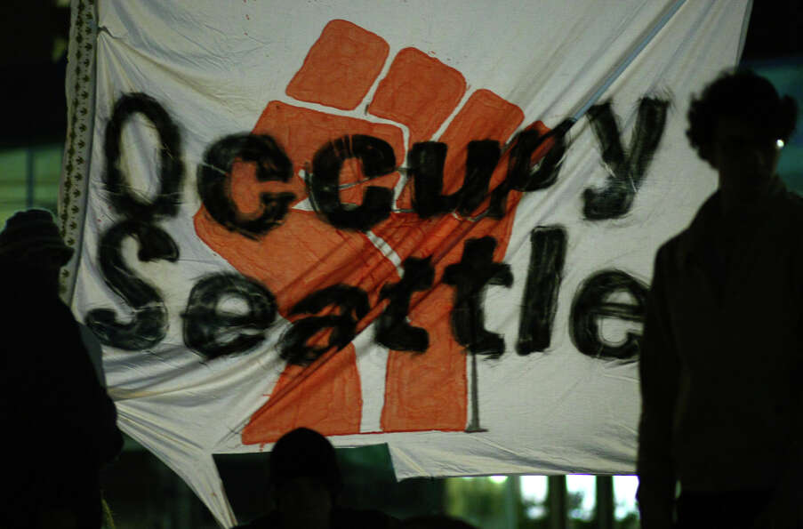 An Occupy Seattle sign is shown at Westlake Park on Wednesday, October 12, 2011.