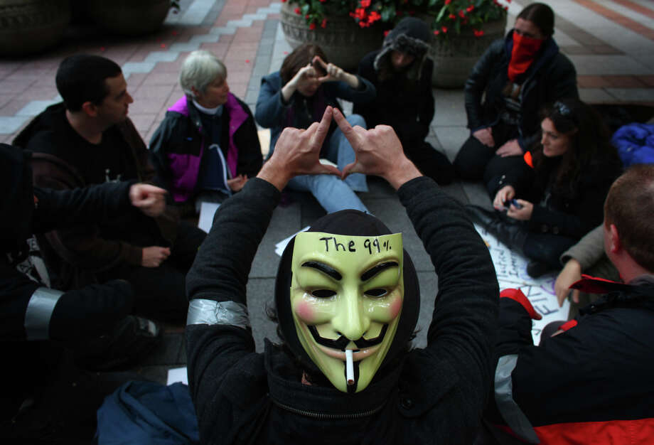 Occupy Seattle demonstrators vote during a meeting at Westlake Park on Friday, October 7, 2011. Community meetings and community decisions are a hallmark of the Occupy movement. Photo: JOSHUA TRUJILLO / SEATTLEPI.COM