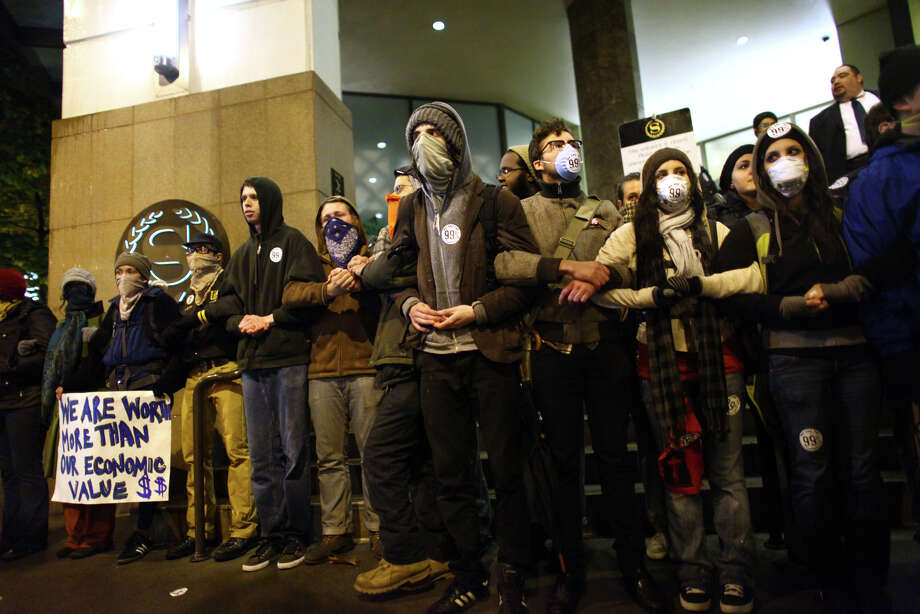 Protesters try to block access to the Sheraton Hotel during an Occupy Seattle protest where Chase Bank CEO Jamie Dimon was speaking on Wednesday, November 2, 2011. A few hundred people tried to block the doors to the hotel during the event hosted by the University of Washington business school. Photo: JOSHUA TRUJILLO / SEATTLEPI.COM