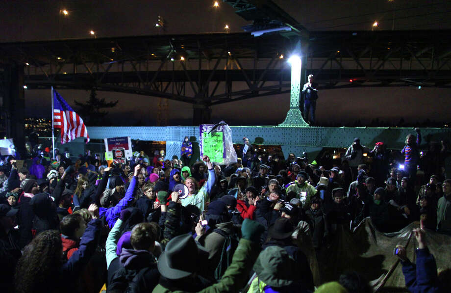 Protesters gather on the University Bridge in Seattle during an Occupy Seattle and labor union protest. Occupy Seattle protesters and labor union members gathered on the bridge to call for the government to spend more money on infrastructure. The protesters shut down the Seattle bridge during rush hour. Photo: JOSHUA TRUJILLO / SEATTLEPI.COM