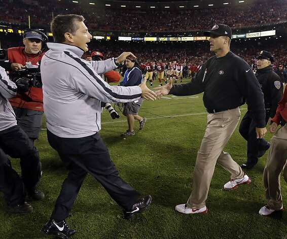 Detroit Lions head coach Jim Schwartz, left, shakes hands with San Francisco 49ers head coach Jim Harbaugh at the end of an NFL football game in San Francisco, Sunday, Sept. 16, 2012. San Francisco won 27-19.  (AP Photo/Marcio Jose Sanchez) Photo: Marcio Jose Sanchez, Associated Press