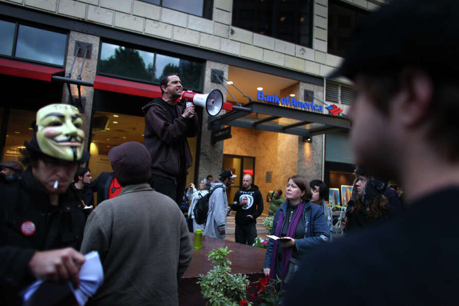 Occupy Seattle demonstrators begin their general assembly meeting in front of Bank of America at Wes