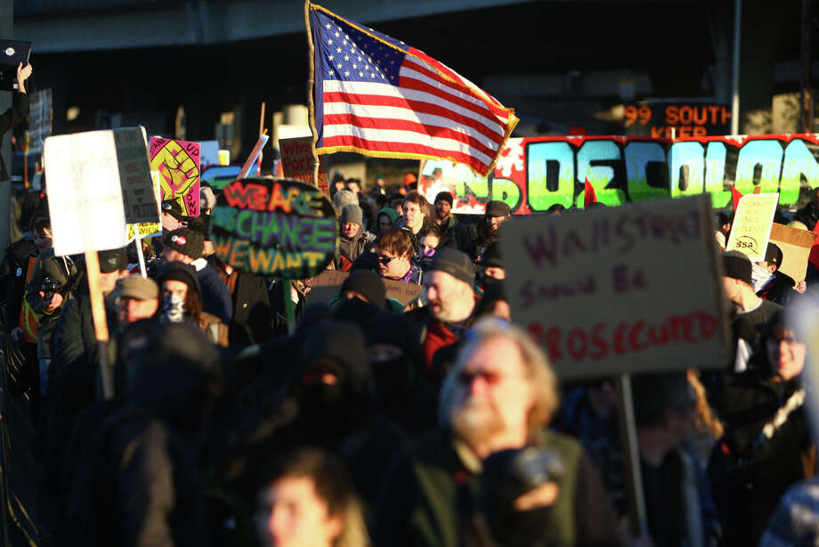Protesters march toward the Port of Seattle on Monday, December 12, 2011. Hundreds of anti-Wall Street protesters gathered at the port and tried to shut down operations. Photo: JOSHUA TRUJILLO / SEATTLEPI.COM