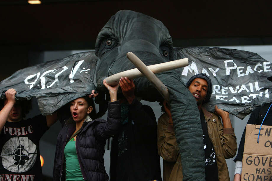 Protesters hoist a prop as thousands of Occupy Seattle people take to the streets of downtown Seattle during the second week of the local protest held in solidarity with Occupy Wall Street. Photo: JOSHUA TRUJILLO / SEATTLEPI.COM