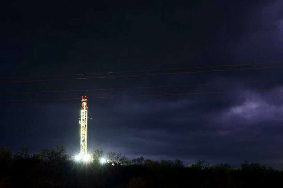 A passing storms lights up the sky with ligthning by a rig near IH-37 South near Whitsett, Wednesday, March 29, 2012. Jerry Lara/San Antonio Express-New
