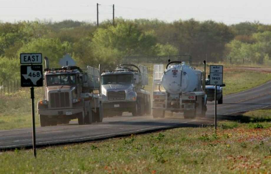 Truck traffic on East 468 Traffic on roads throughout the Eagle Ford Shale in South Texas, Wednesday, March 21, 2012. Jerry Lara/San Antonio Express-News