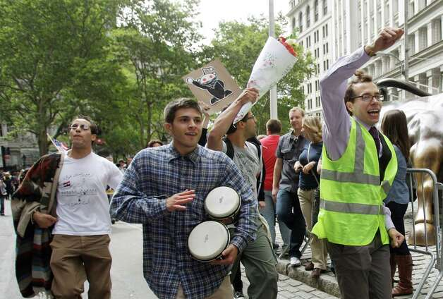 FILE - In this Sept. 17, 2011 file photo, a man beats a pair of bongo drums as demonstrators affiliated with the Occupy Wall Street movement gather to call for the occupation of Wall Street in New York. Monday, Sept. 17, 2012 marks the one-year anniversary of the Occupy Wall Street movement. (AP Photo/Frank Franklin II, File) Photo: Frank Franklin II