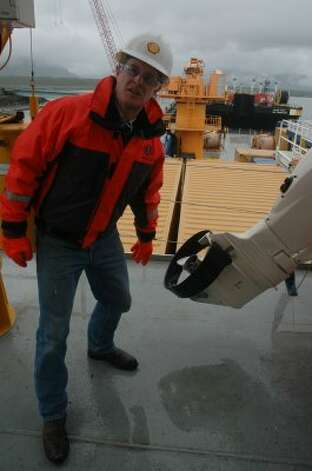 Geoff Merrell, superintendent of emergency response for Shell Alaska, shows one of the improvements made to the Nanuq -- and its support vessels -- for Arctic conditions. This life boat has a collar around its propeller to prevent ice from clogging it. It also is made of stainless steel instead of bronze. (Jennifer A. Dlouhy / The Houston Chronicle)