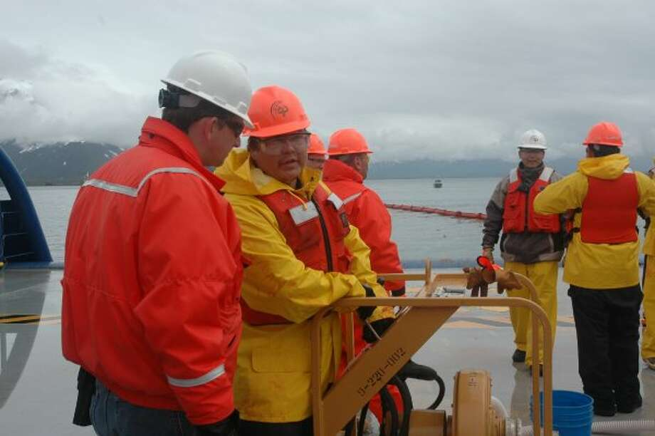 Workers discuss operations during oil spill response training for Shell in Valdez, Alaska. (Jennifer A. Dlouhy / The Houston Chronicle)