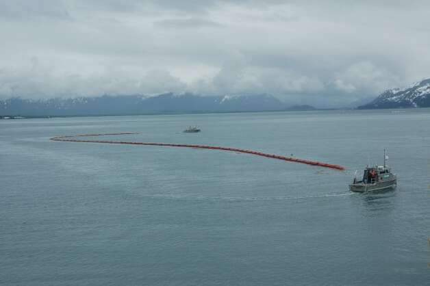 Inflatable boom stretches between two oil spill response vehicles in Valdez waters during a Shell training exercise. (Jennifer A. Dlouhy / The Houston Chronicle)