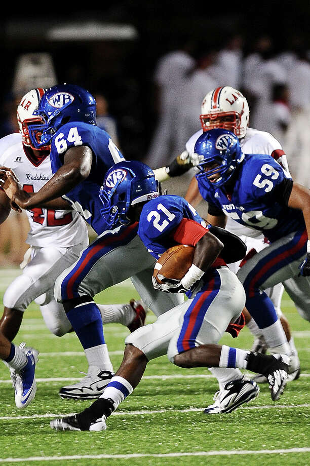 West Brook running back Cameron McBride takes an inside hand-off to gain a few yards in the 2nd quarter at the Beaumont ISD Thomas Center on Saturday, September 15, 2012. Photo taken: Randy Edwards/The Enterprisef