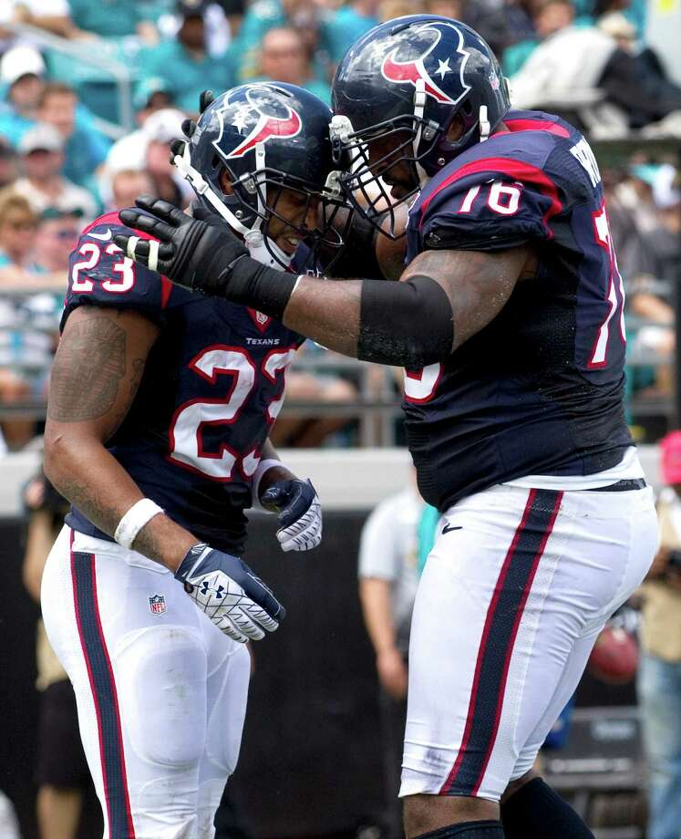 Houston Texans running back Arian Foster (23) and Houston Texans tackle Duane Brown (76) celebrate Foster's 1-yard touchdown run against the Jacksonville Jaguars during the first quarter at EverBank Field, on September 16, 2012 in Jacksonville, Fla. The Texans beat the Jaguars 27-7. Photo: Brett Coomer, Houston Chronicle / © 2012  Houston Chronicle