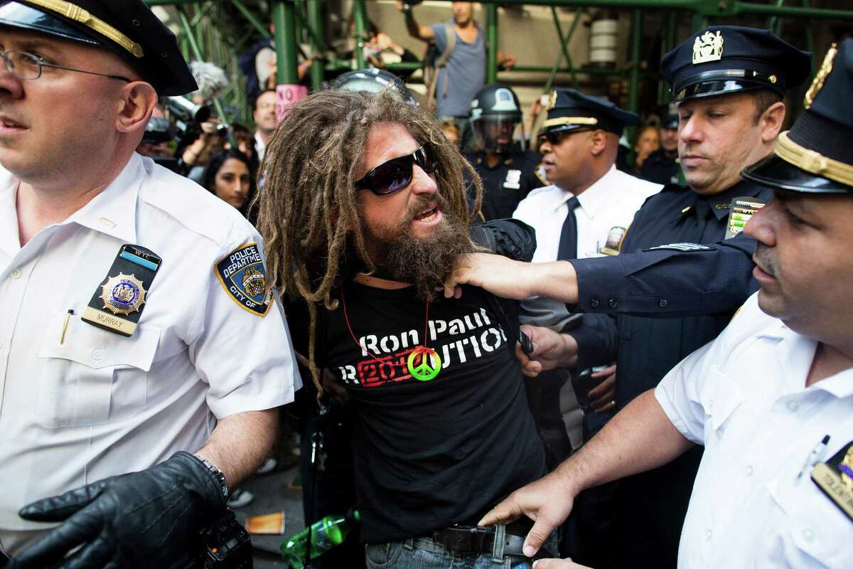 A.J. Redkey is arrested during an Occupy Wall Street march, Monday, Sept. 17, 2012, in New York. A handful of Occupy Wall Street protestors have been arrested during a march toward the New York Stock Exchange on the anniversary of the grass-roots movement.
