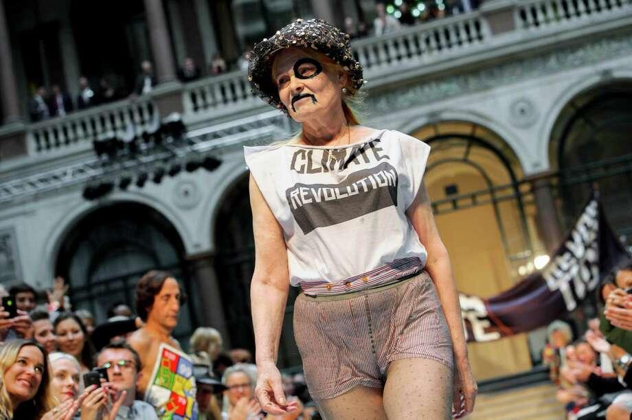 British designer Vivienne Westwood receives applause during London Fashion Week, Sunday, Sept. 16, 2012. Photo: Jonathan Short, AP / AP