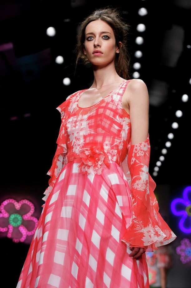 A model wears a design from the Jasper Conran Spring/Summer 2013 collection during London Fashion Week, Saturday, Sept. 15, 2012. Photo: Jonathan Short, AP / AP