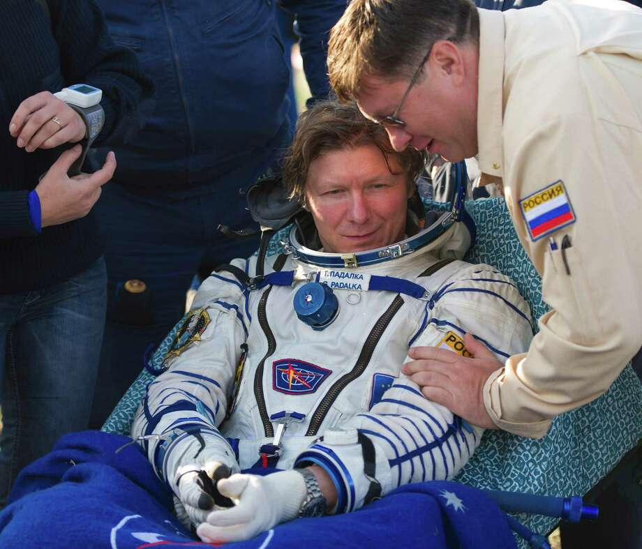 Expedition 32 commander Gennady Padalka rests outside the Soyuz TMA-04M capsule just minutes after he and Expedition 32 NASA flight engineer Joe Acaba and Russian flight engineer Sergei Revin landed in a remote area outside of the town of Arkalyk, Kazakhstan, on Monday, Sept. 17, 2012. Padalka, Acaba and Revin are returning from five months onboard the International Space Station where they served as members of the Expedition 31 and 32 crews.  (AP Photo/NASA, Carla Cioffi)  MANDATORY CREDIT Photo: Carla Cioffi, AP / NASA