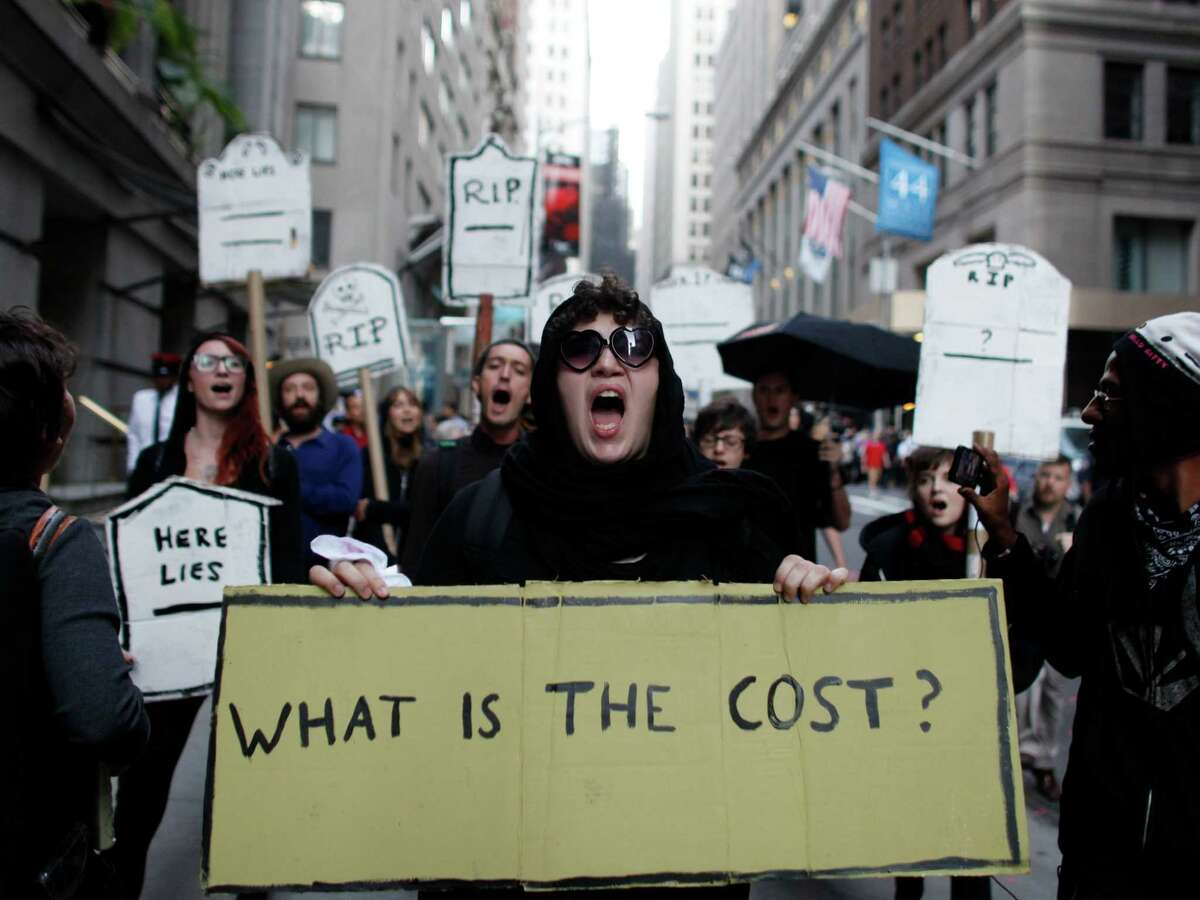 Protestors chant during an Occupy Wall Street march, Monday, Sept. 17, 2012, in New York. A handful of Occupy Wall Street protestors were arrested during a march on the New York Stock Exchange on the anniversary of the grass-roots movement.
