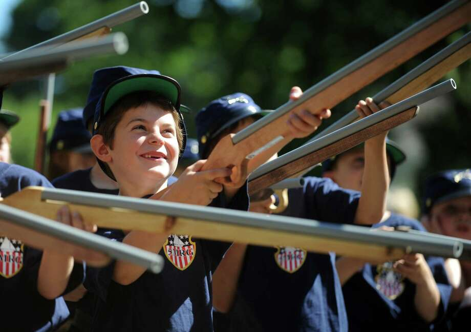 Six-year-old Kai Henry, of Rowayton, aims his rifle while being a soldier for the day during the Rowayton Historical Society's Civil War Encampment Saturday, Sept. 15, 2012 at Pinkney Park in the Rowayton section of Norwalk. Photo: Autumn Driscoll / Connecticut Post