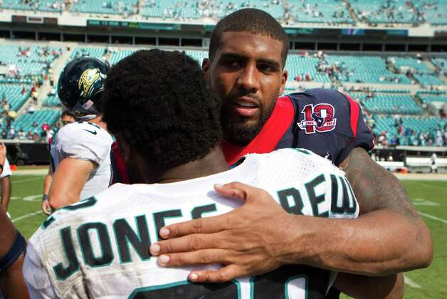 Houston Texans running back Arian Foster embraces Jacksonville Jaguars running back Maurice Jones-Drew after the Texans beat the Jaguars at EverBank Field Sunday, Sept. 16, 2012, in Jacksonville. The Texans beat the Jaguars 27-7. ( Brett Coomer / Houston Chronicle ) Photo: Brett Coomer, Staff / © 2012  Houston Chronicle