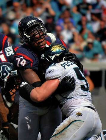 Houston Texans guard Wade Smith (74) blocks Jacksonville Jaguars middle linebacker Paul Posluszny (51) during the second half of an NFL football game, Sunday, Sept. 16, 2012, in Jacksonville, Fla. The Texans beat the Jaguars 27-7. (AP Photo/Stephen Morton) Photo: STEPHEN MORTON, FRE / FR56856 AP