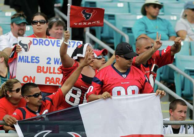 Houston Texans fans cheer for their team during the second half an NFL football game against the Jacksonville Jaguars, Sunday, Sept. 16, 2012, in Jacksonville, Fla. (AP Photo/John Raoux) Photo: John Raoux, STF / AP