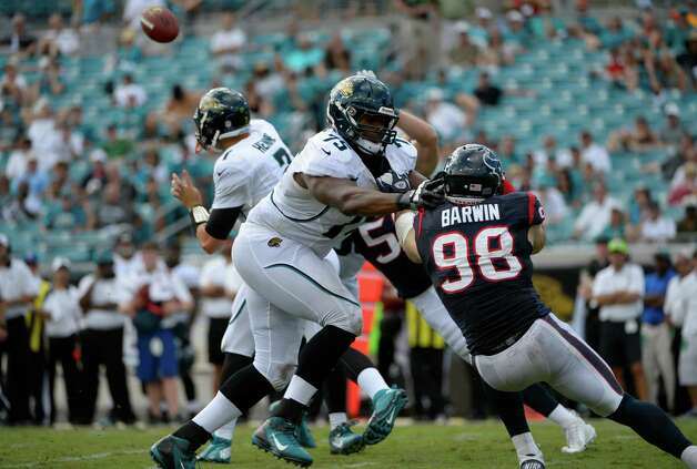 Jacksonville Jaguars tackle Eugene Monroe (75) blocks Houston Texans outside linebacker Connor Barwin (98) during the second half of an NFL football game in Jacksonville, Fla., Sunday, Sept. 16, 2012.(AP Photo/Phelan M. Ebenhack) Photo: Phelan M. Ebenhack, FRE / FR121174 AP