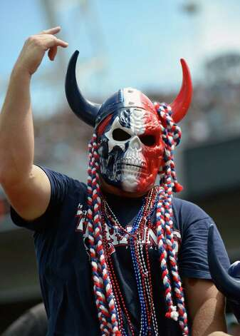 A Houston Texans fans cheers for his team during the first half an NFL football game against the Jacksonville Jaguars, Sunday, Sept. 16, 2012, in Jacksonville, Fla. (AP Photo/Phelan M. Ebenhack) Photo: Phelan M. Ebenhack, FRE / FR121174 AP