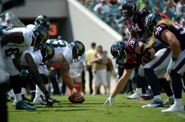 The Jacksonville Jaguars offense, left, and Houston Texans defense line up at the line of scrimmage during the second half of an NFL football game in Jacksonville, Fla., Sunday, Sept. 16, 2012.(AP Photo/Phelan M. Ebenhack) Photo: Phelan M. Ebenhack, FRE / FR121174 AP