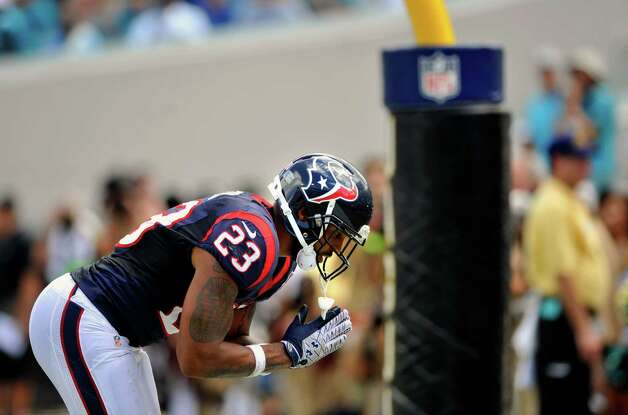 Houston Texans running back Arian Foster (23) celebrates in the end zone after scoring a touchdown during the first half of an NFL football game against the Jacksonville Jaguars, Sunday, Sept. 16, 2012, in Jacksonville, Fla. The Texans beat the Jaguars 27-7. (AP Photo/Stephen Morton) Photo: STEPHEN MORTON, FRE / FR56856 AP