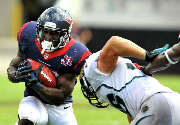 Houston Texans running back Justin Forsett , left, runs for yardage against Jacksonville Jaguars outside linebacker Kyle Bosworth during the second half of an NFL football game on Sunday, Sept. 16, 2012, in Jacksonville, Fla. The Texans defeated the Jaguars 27-7. (AP Photo/Stephen Morton) Photo: Stephen Morton, FRE / FR56856 AP