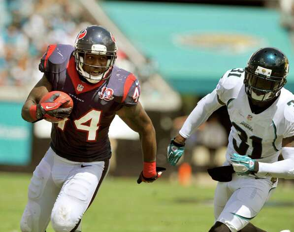 Houston Texans running back Ben Tate (44) runs away from Jacksonville Jaguars cornerback Aaron Ross (31) during the first half of an NFL football game against the Houston Texans, Sunday, Sept. 16, 2012, in Jacksonville, Fla. The Texans beat the Jaguars 27-7. (AP Photo/Stephen Morton) Photo: STEPHEN MORTON, FRE / FR56856 AP