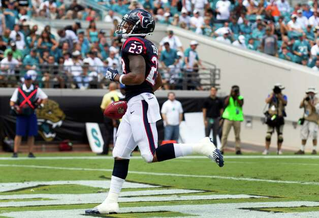 Houston Texans running back Arian Foster (23) jogs across the end zone after scoring a touchdown on a 1-yard run against the Jacksonville Jaguars during the first quarter at EverBank Field, on September 16, 2012 in Jacksonville, Fla. The Texans beat the Jaguars 27-7. ( Brett Coomer / Houston Chronicle ) Photo: Brett Coomer, Staff / © 2012  Houston Chronicle