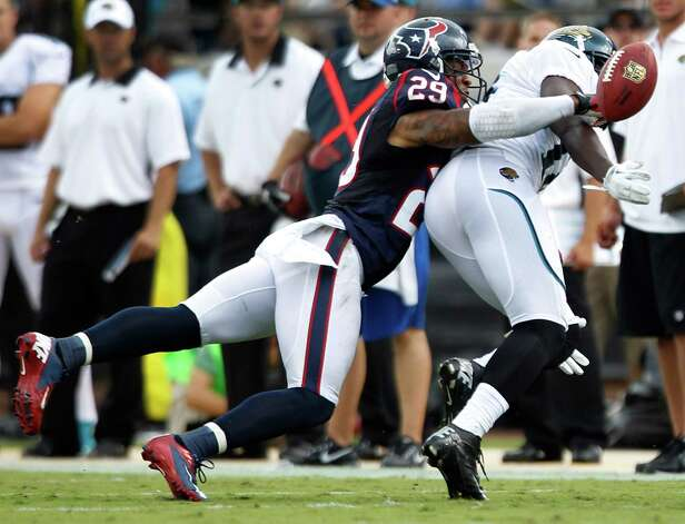 Houston Texans strong safety Glover Quin (29) breaks up a pass intended for Jacksonville Jaguars wide receiver Justin Blackmon (14) during the second quarter at EverBank Field Sunday, Sept. 16, 2012, in Jacksonville, Fla. The Texans beat the Jaguars 27-7. ( Brett Coomer / Houston Chronicle ) Photo: Brett Coomer, Staff / © 2012  Houston Chronicle