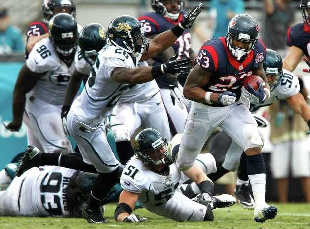 Houston Texans running back Arian Foster (23) runs past Jacksonville Jaguars free safety Dawan Landry (26) and linebacker Paul Posluszny (51) during the second quarter at EverBank Field Sunday, Sept. 16, 2012, in Jacksonville, Fla. The Texans beat the Jaguars 27-7. ( Brett Coomer / Houston Chronicle ) Photo: Brett Coomer, Staff / © 2012  Houston Chronicle