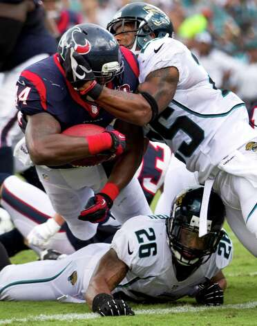 Houston Texans running back Ben Tate (44) powers past Jacksonville Jaguars strong safety Dwight Lowery (25) and Jacksonville Jaguars free safety Dawan Landry (26) for an 8-yard touchdown run during the second quarter at EverBank Field Sunday, Sept. 16, 2012, in Jacksonville, Fla. The Texans beat the Jaguars 27-7. ( Brett Coomer / Houston Chronicle ) Photo: Brett Coomer, Staff / © 2012  Houston Chronicle