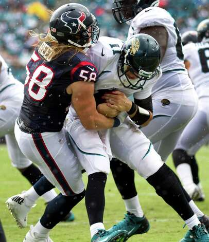 Houston Texans outside linebacker Brooks Reed (58) sacks Jacksonville Jaguars quarterback Blaine Gabbert (11) during the second quarter at EverBank Field Sunday, Sept. 16, 2012, in Jacksonville, Fla. The Texans beat the Jaguars 27-7. ( Brett Coomer / Houston Chronicle ) Photo: Brett Coomer, Staff / © 2012  Houston Chronicle