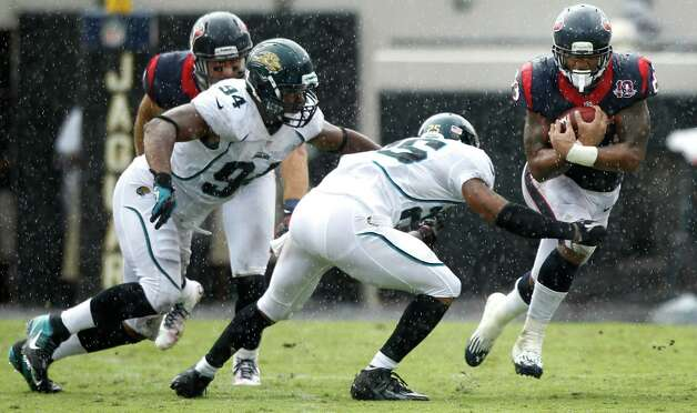 Houston Texans running back Arian Foster (23) cuts back across the field past Jacksonville Jaguars strong safety Dwight Lowery (25) and defensive end Jeremy Mincey (94) during the second quarter at EverBank Field Sunday, Sept. 16, 2012, in Jacksonville, Fla. The Texans beat the Jaguars 27-7. ( Brett Coomer / Houston Chronicle ) Photo: Brett Coomer, Staff / © 2012  Houston Chronicle
