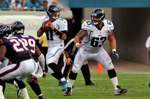 Jacksonville Jaguars center Brad Meester (63) drops back into protection while Jacksonville Jaguars quarterback Blaine Gabbert (11) looks to pass during the first half of an NFL football game against the Houston Texans, Sunday, Sept. 16, 2012, in Jacksonville, Fla. The Texans beat the Jaguars 27-7. (AP Photo/Stephen Morton) Photo: STEPHEN MORTON, FRE / FR56856 AP