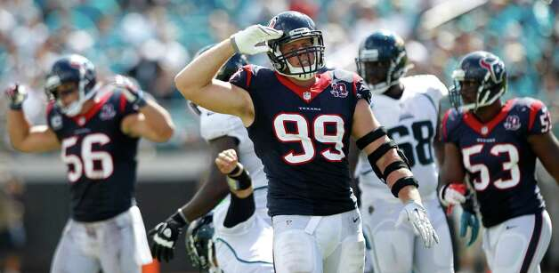 Houston Texans defensive end J.J. Watt (99) salutes as he celebrates his sack of Jacksonville Jaguars quarterback Blaine Gabbert during the fourth quarter at EverBank Field Sunday, Sept. 16, 2012, in Jacksonville. The Texans beat the Jaguars 27-7. ( Brett Coomer / Houston Chronicle ) Photo: Brett Coomer, Staff / © 2012  Houston Chronicle