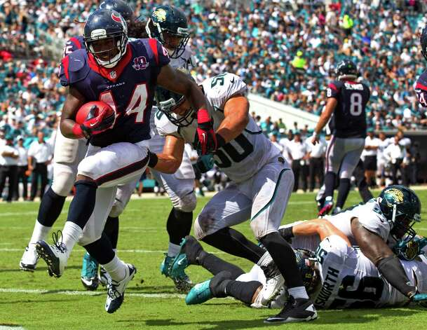 Houston Texans running back Ben Tate (44) runs past Jacksonville Jaguars outside linebacker Russell Allen (50) for a 2-yard touchdown during the third quarter at EverBank Field Sunday, Sept. 16, 2012, in Jacksonville, Fla. The Texans beat the Jaguars 27-7. ( Brett Coomer / Houston Chronicle ) Photo: Brett Coomer, Staff / © 2012  Houston Chronicle