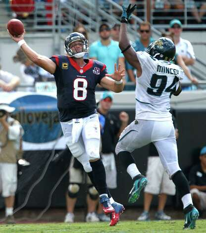 Houston Texans quarterback Matt Schaub (8) throws a pass as he is pressured by Jacksonville Jaguars defensive end Jeremy Mincey (94) during the fourth quarter at EverBank Field Sunday, Sept. 16, 2012, in Jacksonville. The Texans beat the Jaguars 27-7. ( Brett Coomer / Houston Chronicle ) Photo: Brett Coomer, Staff / © 2012  Houston Chronicle