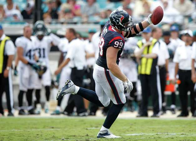 Houston Texans defensive end J.J. Watt (99) runs with the football after recovering a fumbled snap by Jacksonville Jaguars quarterback Chad Henne during the fourth quarter at EverBank Field Sunday, Sept. 16, 2012, in Jacksonville. The Texans beat the Jaguars 27-7. ( Brett Coomer / Houston Chronicle ) Photo: Brett Coomer, Staff / © 2012  Houston Chronicle