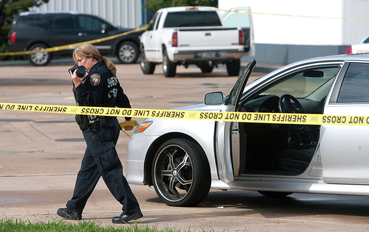 Police investigate the scene of a fatal shooting at a gas station at the intersection of Perry Road and FM 1960 Monday, Sept. 17, 2012, in Houston.
