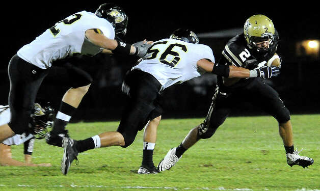 Nederland's Michael Shaw tries to get past Vidor's Zayne Simmons at Bulldog Stadium in Nederland, Friday, September 23, 2011   Tammy McKinley/The Enterprise Photo: TAMMY MCKINLEY