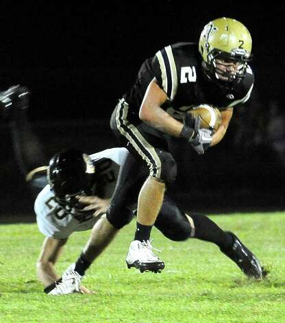 Nederland's Michael Shaw slips past Vidor's Jimmy Wright at Bulldog Stadium in Nederland, Friday, September 23, 2011   Tammy McKinley/The Enterprise Photo: TAMMY MCKINLEY